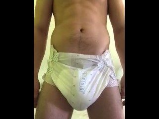 Wetting my diaper and squeeze the pee