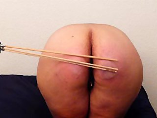 Spanker Machine paddle and cane a big butt