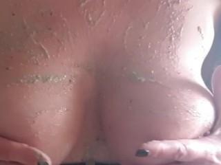 Nasty milf spills smoothie on big tits