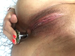 Shoving a buttplug in a tight ass
