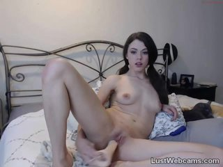 Cute brunette toys her pussy on webcam