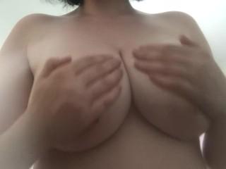 Rubbing oil on my DD tits