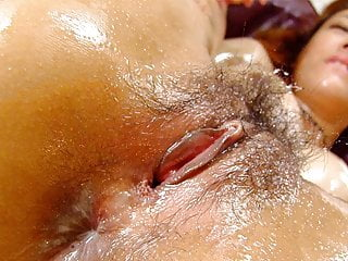 Oiled up and hairy Asian skank finger fucked and toyed