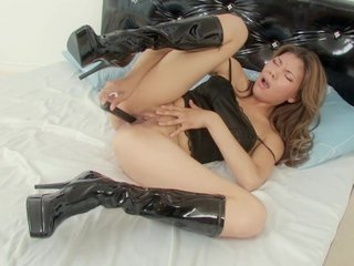 Sexy asian girl uses vibrator to have some pleasure