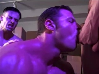 Two huge bodybuilders fuck with a hot young jock