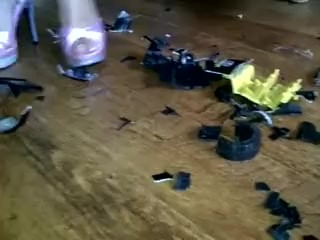 Ruby crushing a toy car in high heels