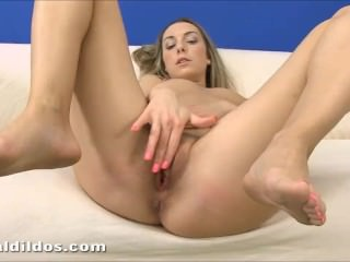 Petite blonde Foxies fills her pussy with a thick dildo