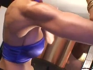 Sandi oiled up & flexing her muscle