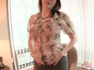 hot secretary in glasses strips at home