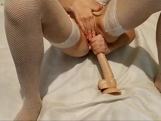 Amateur milf plays with long dildo lingerie stockings