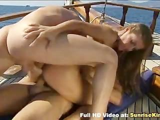 Rita Faltoyano and two cocks on the boat