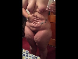BBW housewife oiling her curvacious body