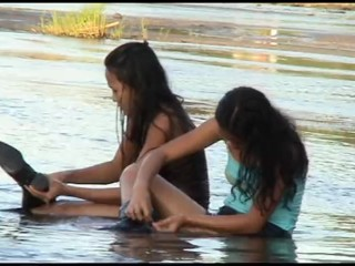 two girls wet in river