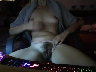 Gamer girl touches her hairy pussy after winning a match