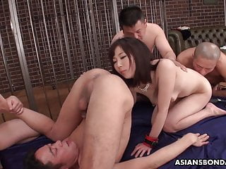 Erika Akagi is licking ass during a group sex session