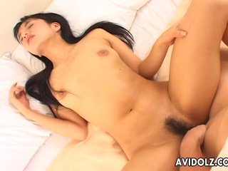 Beautiful Asian babe in bed getting rocked with a cock