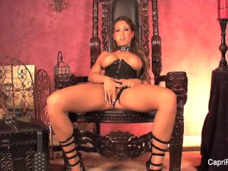 Brunette hottie Capri masturbates on her throne