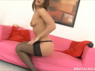 Gorgeous brunette filling her pussy with a massive dildo
